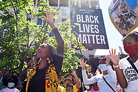 """Youth activist Ashleigh McNeill leads a prayer at Black Lives Matter Plaza with members of #YouthSpeakUP, who marched in solidarity with the """"Black Lives Matter"""" movement against racial injustice onSaturday, June 13 in Washington, D.C."""