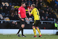 Burton Albion forward Liam Boyce (27) protests to Referee Brett Huxtable during the EFL Sky Bet League 1 match between Burton Albion and Oxford United at the Pirelli Stadium, Burton upon Trent, England on 2 February 2019.