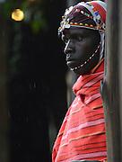 Kenya, Local man in traditional dress awaiting tourists