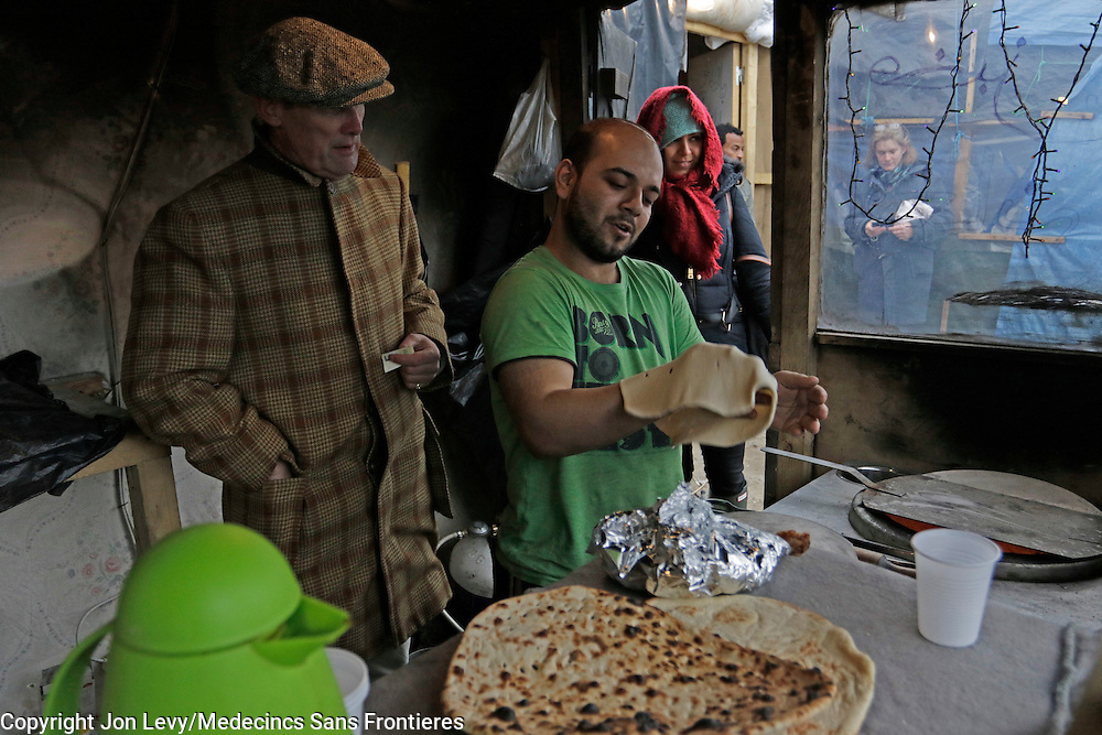 Writer AA Gill watches a baker from Barri Italy make naan bread in a small make-shift bakery in the refugee camp in Calais France. <br /><br />Calais: AA Gill visits the refugee camps of Calais and Grande Synthe in Dunkirk.