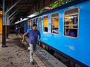 07 OCTOBER 2017 - COLOMBO, SRI LANKA: A man runs to catch a departing train at the Fort Station in Colombo. The Fort Station is Colombo's main train station and serves as the hub of Sri Lanka's train system. The station opened in 1917 and is modeled after Manchester Victoria Station.    PHOTO BY JACK KURTZ