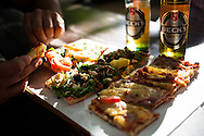 Street pizza and beer on a summer day in the Mitta, Berlin, Germany