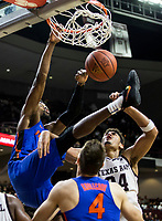 Florida forward Kevarrius Hayes (13) dunks the ball over Texas A&M center Tyler Davis (34) during the second half of an NCAA college basketball game Tuesday, Jan. 2, 2018, in College Station, Texas. (AP Photo/Sam Craft)