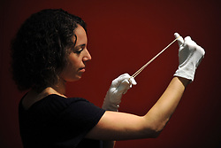 © Licensed to London News Pictures. 08/11/2011. London, UK. Kate Poulter, a science museum member of staff, stretches an elastic band featured in the exhibition. Hidden Heroes photocall at the Science Museum, London today 8th November 2011. The exhibition celebrates everyday items and is open from 9th November 2011. Photo credit : Stephen Simpson/LNP