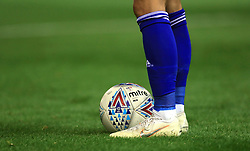 Close up of the Mire official match ball and Birmingham City player's feet