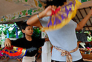 Young boy and his teacher, traditional Balinese dance school. Sanur, Bali, Indonesia.