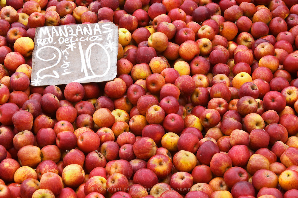 A market stall street market merchant selling apples in a big pile, Manzana Red Delicious Montevideo, Uruguay, South America