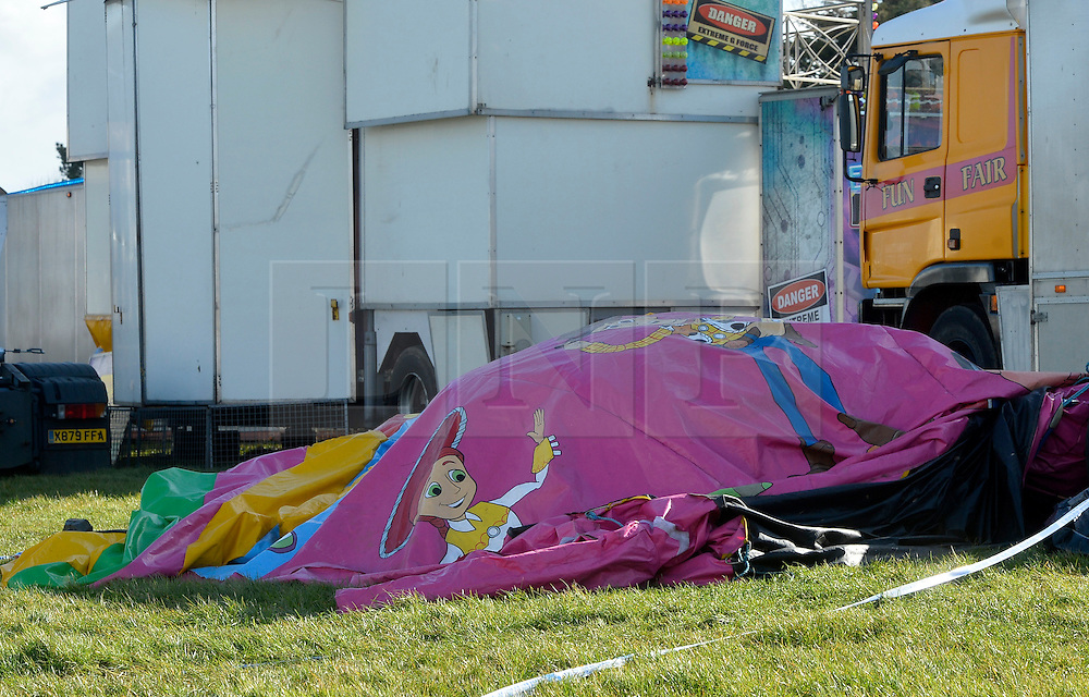 """© Licensed to London News Pictures. 27/03/2016. London, UK. A general view of the bouncy castle where a girl died that she was playing in when it """"blew away by some distance"""". Two people are being held on suspicion of manslaughter by gross negligence following the incident which took place in Harlow Town Park in Essex. Photo credit : Hannah McKay/LNP"""