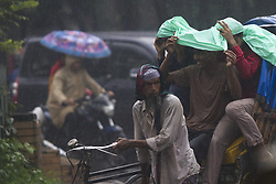 June 17, 2017 - Dhaka, Bangladesh - DHAKA, BANGLADESH - JUNE 17 : Bangladeshi people seen on street during heavy rainfall in Dhaka, Bangladesh on June 17, 2017..The death toll rises to 156 in several hill districts including Rangamati, Banderban, and Chittagong after the landslides following heavy downpour in those areas. The road communication has been broken so rescue workers could not operate with thier full speed and no relief has been reached to the affected areas. (Credit Image: © Zakir Hossain Chowdhury via ZUMA Wire)