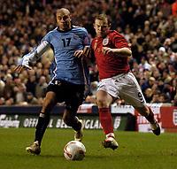 Photo: Jed Wee.<br /> England v Uruguay. International Friendly. 01/03/2006.<br /> <br /> England's Wayne Rooney (R) tries to take on Uruguay's Carlos Diogo.