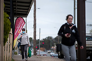Locals are seen walking in the main street during COVID-19 in Kilmore, Australia. An outbreak which started in Chadstone in Melbourne, has spread as far as Benalla. Twenty-eight people linked to the outbreak have now tested positive for COVID-19. There are now two confirmed cases in Kilmore linked with a Melbourne Resident who carried the virus into the town. The person visited the Odd Fellows Cafe in Kilmore which lead to him spreading the virus to a staff member, and a customer. The cafe has been closed for deep cleaning and will remain closed until the 19th October. (Photo by Dave Hewison/Speed Media)