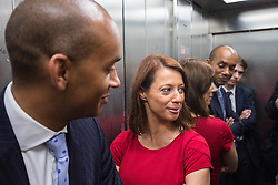 © Licensed to London News Pictures. 20/07/2015. London, UK. Gloria De Piero (centre) and Chuka Umunna (left) pictured in a lift after visiting Roupell Park Estate in Brixton to talk about renewable energy with Labour leadership candidate Liz Kendall (not pictured). Photo credit : James Gourley/LNP
