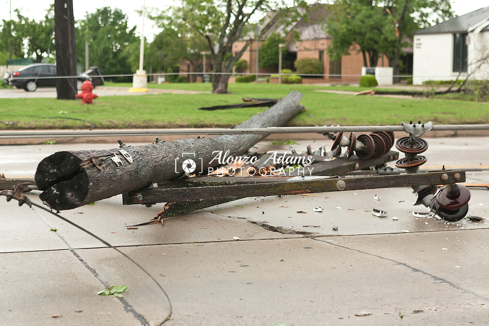 Power lines lay across 24th Ave SW near Lindsey Street in Norman, Okla. after a tornado hit the area on Friday, April 13, 2012.  (Photo by Alonzo J. Adams)