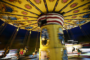 Crowds fly through the night on an amusement ride at the Evergreen State Fair. (Erika Schultz / The Seattle Times)