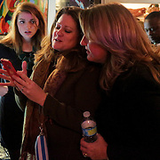 Campaign Manager Erin Rogers, left, Rep. Susi Hamilton, center, and Candidate for NC Senate District 9 Elizabeth Redenbaugh watch election results at Ted's Fun on the River Tuesday November 4, 2014 in Wilmington, N.C. (Jason A. Frizzelle)