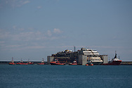 Italian prime minister leaves the Voltri port giving a speech at the end of the docking operation of the Costa Concordia