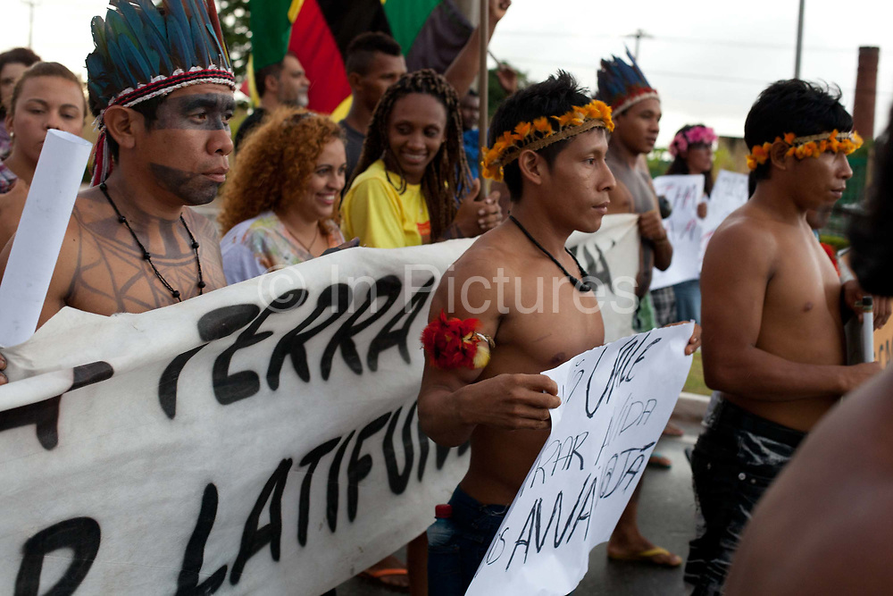 Indiegnous people protesting against Vale, Sao Luis, Brazil. The Carajas Open Cast Iron Ore mine is the largest iron mine in the World, estimates say the site can be mined at today's rates for another 400 years. In the Amazonian State of Para in the north of Brazil, it is operated by the State owned Vale mining corporation, prevoously CVRD. The company has come under some controversy about the mine, and recently has started expanding the mine on the site of a series of ancient caves.