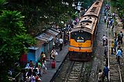 People waiting for local train at Phaya Thi station in central Bangkok