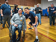 12 DECEMBER 2019 - DES MOINES, IOWA: ANDREW YANG poses for a selfie with a man after a basketball game with J.D. Scholten in the gym in the Ames, IA, City Hall. Scholten is an Iowa Democrat running against Republican Congressman Steve King. Yang, an entrepreneur, is running for the Democratic nomination for the US Presidency in 2020. He brought bus tour to Ames, IA, Thursday. Iowa hosts the the first election event of the presidential election cycle. The Iowa Caucuses will be on Feb. 3, 2020.        PHOTO BY JACK KURTZ