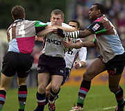 Photo - Peter Spurrier<br /> 08/02/2003 <br /> RUGBY - NEC Harlequins v Sale Sharks<br /> Mark Cueto attacks on the wing and is tackled by Rob Jewell left and Viliame Satala