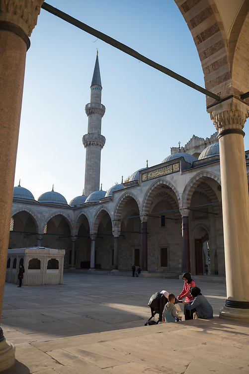 Women and kids enjoy a late afternoon in the courtyard of the Süleymaniye Mosque in Istanbul, Turkey. The mosque was built between 1550 and 1557.