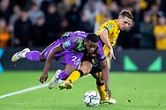 Japhet Tanganga of Tottenham Hotspur battles for possession with Daniel Podence of Wolverhampton Wanderers during the EFL Cup match between Wolverhampton Wanderers and Tottenham Hotspur at Molineux, Wolverhampton, England on 22 September 2021.