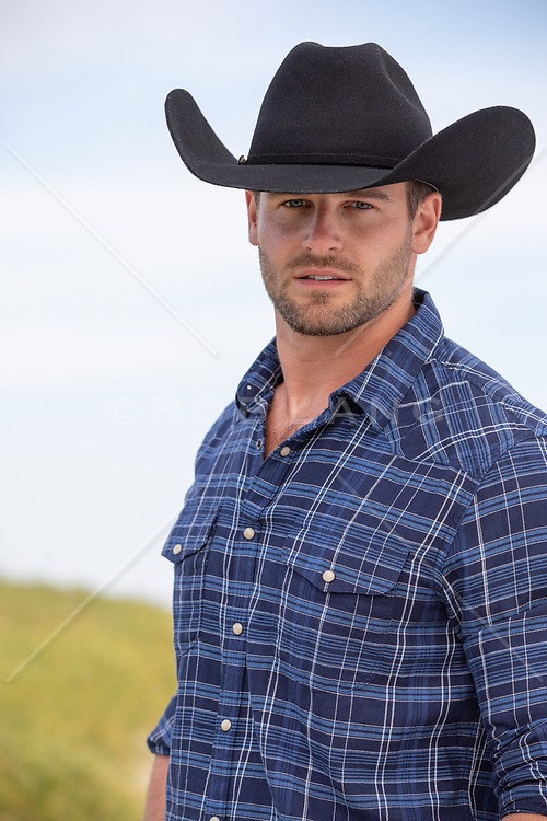 portrait of a hot rugged cowboy