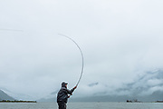 On a rainy day in June, David Page spey casts for chinook at tidewater on BC's Dean River.