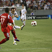 USA midfielder Landon Donovan (10) kicks the ball past Panama defender Luis Henríquez (17)during a CONCACAF Gold Cup soccer match between the United States and Panama on Saturday, June 11, 2011, at Raymond James Stadium in Tampa, Fla. (AP Photo/Alex Menendez)