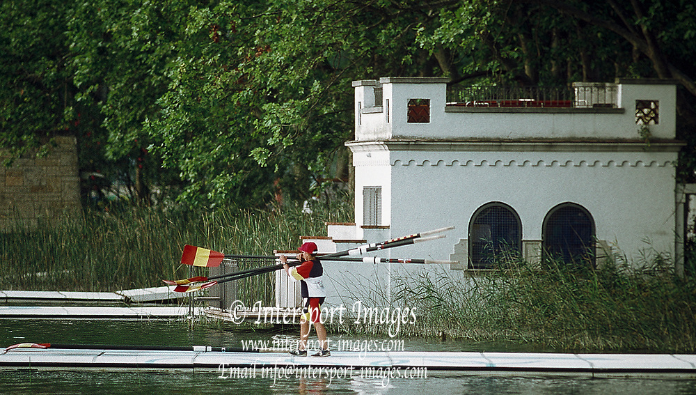 Barcelona,  SPAIN, 1992 Olympic Regatta. Lake Banyoles, Nr Barcelona SPAIN, Spanish Cox carries the blades to the boating pontoon,   [Photo, Peter Spurrier/Intersport-images] GV's