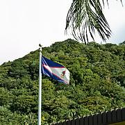 Flag of American Samoa flies proudly; Tutuila Island, American Samoa.