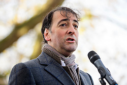 """© Licensed to London News Pictures. 19/11/2016. Richmond, UK. Actor and comedian ALISTAIR MCGOWAN speaking on stage. Campaigners take part in a demonstration against the expansion of Heathrow Airport and the building of a third runway. Former conservative MP Zac Goldsmith is due to take part in a series of events in which some activists have threatened """"direct action"""". Photo credit: Ben Cawthra/LNP"""