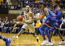 Jan 15, 2018; Morgantown, WV, USA; West Virginia Mountaineers guard Jevon Carter (2) passes the ball during the second half against the Kansas Jayhawks at WVU Coliseum. Mandatory Credit: Ben Queen-USA TODAY Sports
