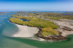 Aerial view from drone of coastal landscape looking towards island of Grimsay on  Benbecula in  the Outer Hebrides, Scotland, UK