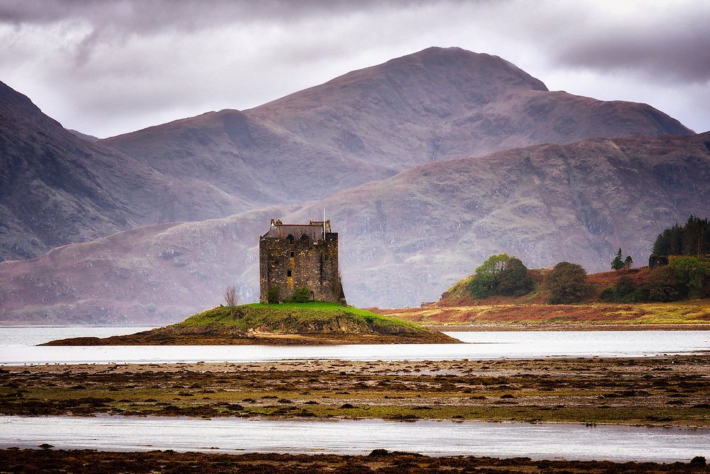 Castle Stalker the elder's ruins appear on the far right. Forsaken, from bitter experience, for the more secure island position. Wildlife abound here under the hulking hills across Loch Linnhe. Kings visited for falconry.  Extreme care is recommended in mounting the stair to enter the castle.