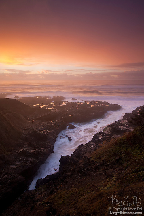 The Pacific Ocean reaches several hundred feet inland at Cooks Chasm, a narrow inlet near Yachats, Oregon.