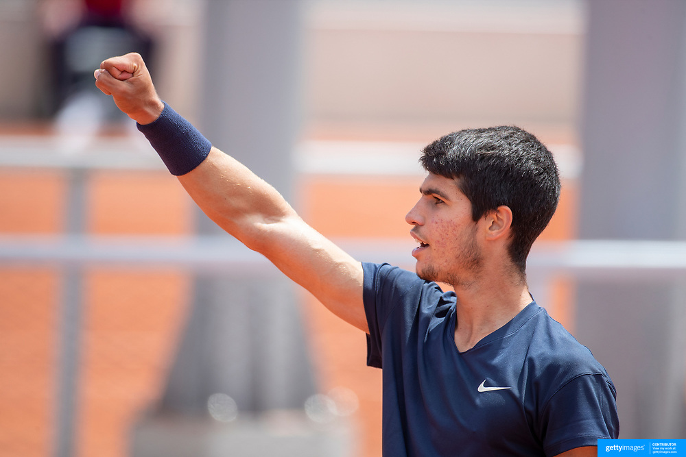 PARIS, FRANCE May 28. Carlos Alcaraz of Spain celebrates his victory against Alejandro Table of Chile during the qualifying tournament at the 2021 French Open Tennis Tournament at Roland Garros on May 28th 2021 in Paris, France. (Photo by Tim Clayton/Corbis via Getty Images)