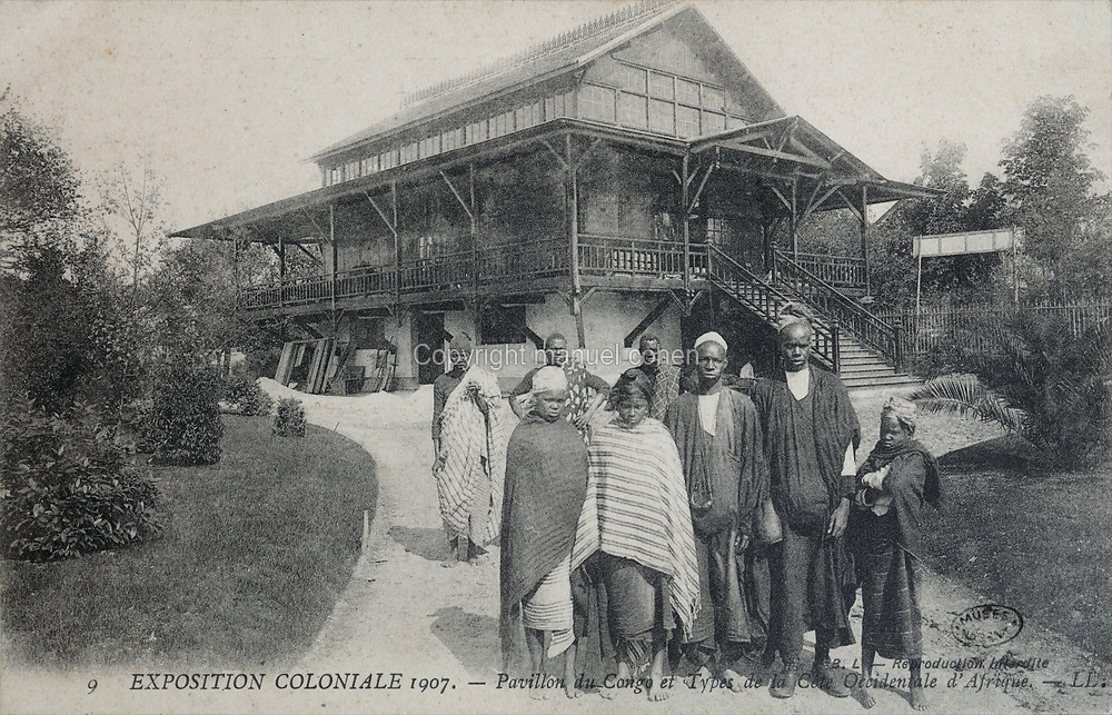 Congo Pavilion and West African people at the Colonial Exhibition of 1907, held in the Jardin d'Agronomie Tropicale, or Garden of Tropical Agronomy, in the Bois de Vincennes in the 12th arrondissement of Paris, postcard from the nearby Musee de Nogent sur Marne, France. The garden was first established in 1899 to conduct agronomical experiments on plants of French colonies. In 1907 it was the site of the Colonial Exhibition and many pavilions were built or relocated here. The garden has since become neglected and many structures overgrown, damaged or destroyed, with most of the tropical vegetation disappeared. The site is listed as a historic monument. Picture by Manuel Cohen / Musee de Nogent sur Marne