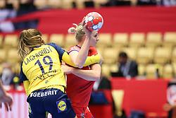 HERNING, DENMARK - DECEMBER 3, 2020: Marketa Jerabkova is held by Anna Lagerquist (19) of Sweden during the EHF Euro 2020 Group C match between Sweden and Czech Republic in Jyske Bank Boxen, Herning, Denmark on December 3 2020. Photo Credit: Allan Jensen/EVENTMEDIA.