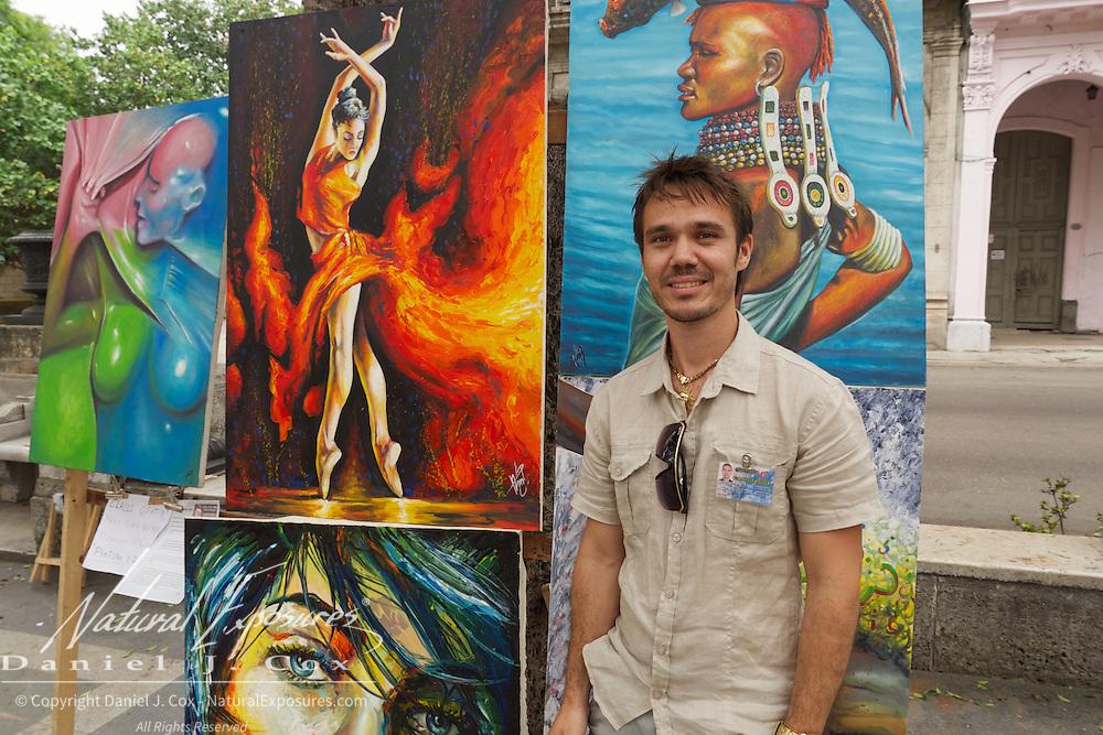 Artist Dairo Marin Pons selling his art work on the Prado in Havana, Cuba.