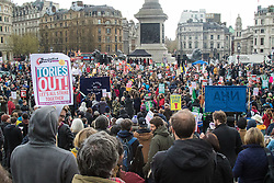 "London, April 16th 2016.Part of the crowd at the Trafalgar Square rally as thousands of people supported by trade unions and other rights organisations demonstrate against the policies of the Tory government, including austerity and perceived favouring of ""the rich"" over ""the poor""."