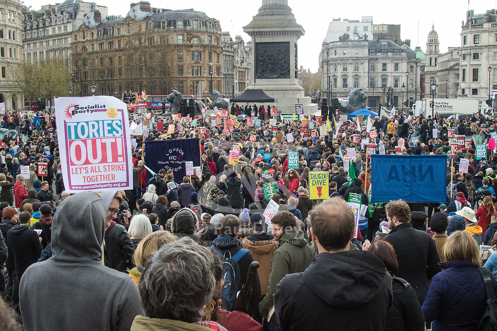 """London, April 16th 2016.Part of the crowd at the Trafalgar Square rally as thousands of people supported by trade unions and other rights organisations demonstrate against the policies of the Tory government, including austerity and perceived favouring of """"the rich"""" over """"the poor""""."""