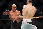 Robbie Lawler throws a kick against Rory MacDonald during UFC 189 at the MGM Grand Garden Arena in Las Vegas, Nevada on July 11, 2015. (Cooper Neill)