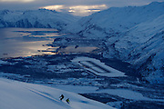 Two snowboarders on the last run of the day above Valdez, Alaska, MR