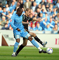 Photo: Ed Godden.<br />Coventry City v Plymouth Argyle. Coca Cola Championship. 30/09/2006. Coventry's Stern John (L) is challenged by Marcel Seip.