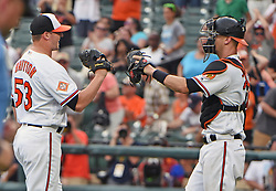 July 23, 2017 - Baltimore, MD, USA - Baltimore Orioles' Zach Britton, left, celebrates with catcher Caleb Joseph after defeating the Houston Astros for his sixth save of the season on Sunday, July 23, 2017 at Oriole Park at Camden Yards in Baltimore, Md. The Orioles defeated the Astros, 9-7. (Credit Image: © Kenneth K. Lam/TNS via ZUMA Wire)
