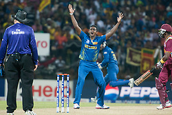 © Licensed to London News Pictures. 29/09/2012. Sri Lankan Ajantha Mendis appeals for a LBW during the T20 Cricket World super 8's match between Sri Lanka Vs West Indies at the Pallekele International Stadium Cricket Stadium, Pallekele. Photo credit : Asanka Brendon Ratnayake/LNP