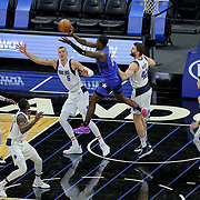 ORLANDO, FL - MARCH 01: Dwayne Bacon #8 of the Orlando Magic passes as Kristaps Porzingis #6 of the Dallas Mavericks and Maxi Kleber #42 of the Dallas Mavericks defend during the second half at Amway Center on March 1, 2021 in Orlando, Florida. NOTE TO USER: User expressly acknowledges and agrees that, by downloading and or using this photograph, User is consenting to the terms and conditions of the Getty Images License Agreement. (Photo by Alex Menendez/Getty Images)*** Local Caption *** Dwayne Bacon; Kristaps Porzingis; Maxi Kleber