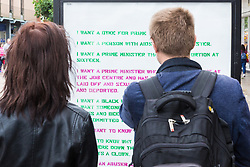 London, UK. 30 July, 2019. Passersby read one of several adhacks attacking Boris Johnson with an adaptation of New York-based artist Zoe Leonard's blistering 'I Want A President' which have appeared around the newly-appointed Prime Minister's constituency of Uxbridge and South Ruislip. They were produced by the artist Protest Stencil in tribute to Zoe Leonard to coincide with the #FckBoris events.