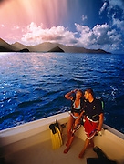 A couple prepares for snorkeling inside of a boat